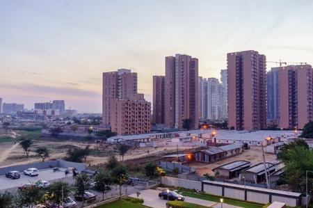 high rise buildings in gurgaon delhi NCR shot at dusk