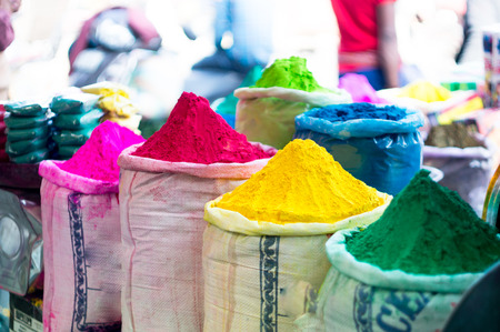Gulal color piled in sacks for indian festival of holi