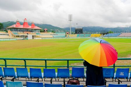 colorful umbrella on the seats of Dharamshala himachal cricket stadium Editorial