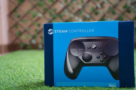 Steam Controller by Valve with its original box in calm early cold morning 写真素材