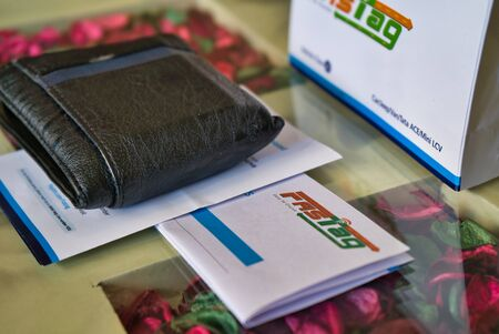 Gurgaon - India, Circa 2019: Photograph of Fast Tag with other application forms for fast tag, fastag, and a wallet on a beautifully decorated table. Fast tag is expected to make toll stops cash and hassle free and was implemented on 15th December 2019