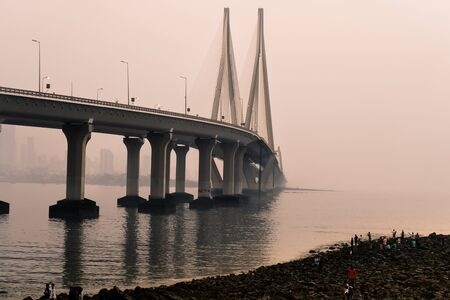 The bandra worli sea link shot at dusk in mumbai a famous landmark that connects the city