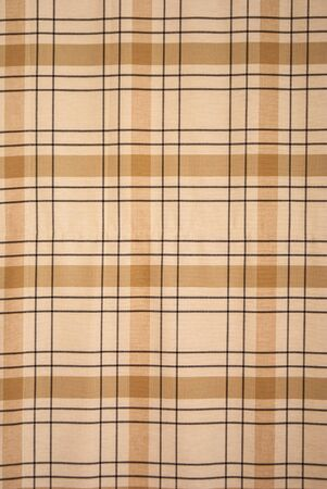 background of brown color  tablecloth tartan pattern photo
