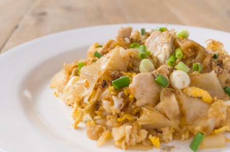 Stir-fried fresh rice-flour noodles with chicken and egg photo