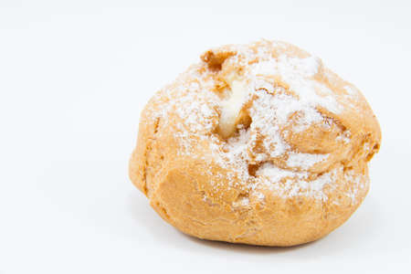 scrumptious: Sweet brown cream choux with icing on a white background.