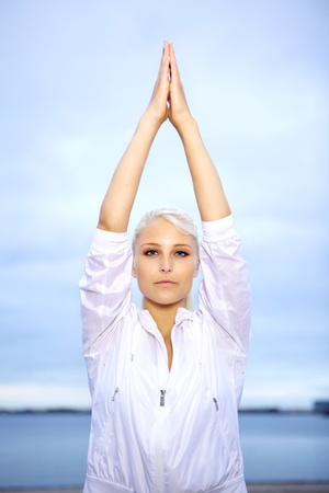 Young woman doing peaceful yoga pose. Stock Photo - 10586639
