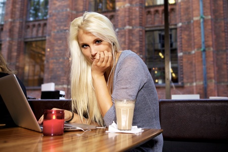 Portrait of a cute girl sitting on a cafe. Stock Photo - 10586662