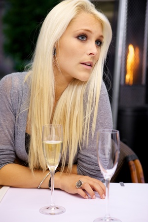 model nice: Young beautiful woman waiting for her date on a restaurant. Stock Photo
