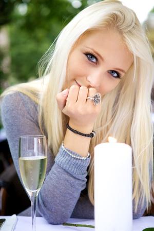 Beautiful young woman looking at you. photo