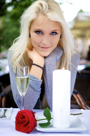Blind Date: Portrait of young beautiful woman on date at a restaurant. Stock Photo