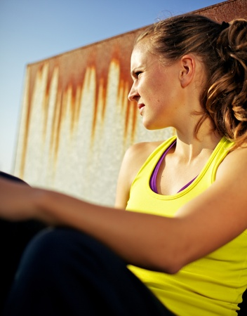 self  discipline: Portrait of Determined Girl in Fitness Clothing with Urban City Background Stock Photo