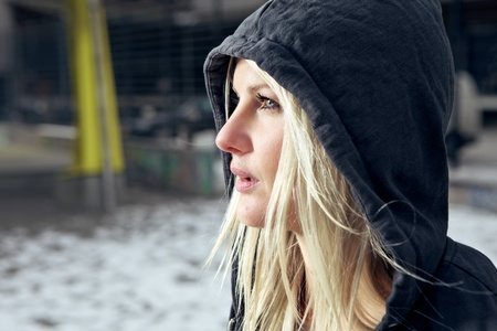 cardigan: Sexy woman wearing a hooded cardigan outside in urban enviroment