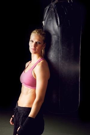 Vertical portrait of a young beautiful female boxer   photo