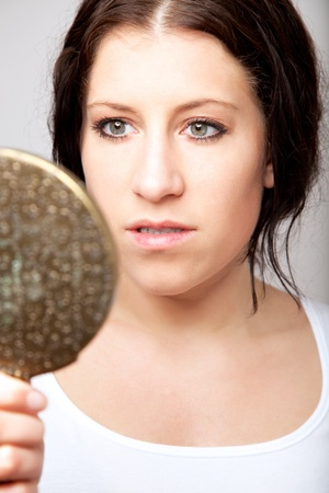 Portrait of a woman looking at herself in the mirror Stock Photo - 13204679
