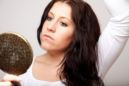 Portrait of a woman staring blankly in the mirror Stock Photo - 13204678