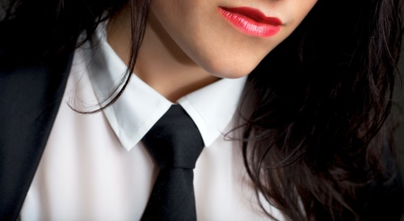 Closeup portrait of a sexy female wearing a tie photo
