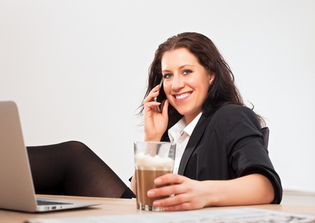 Portrait of a young professional in the office using her phone to talk to someone Stock Photo - 13296213
