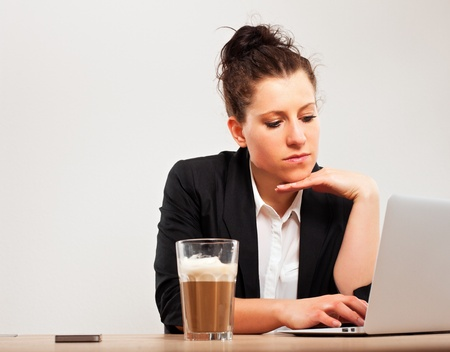 Portrait of a young professional busy with office work Stock Photo - 13296218