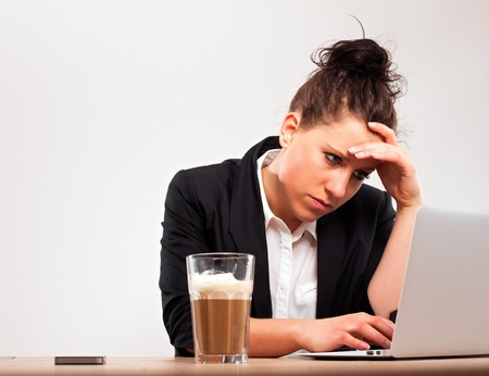 Stressed young professional busy with office work Stock Photo - 13296205