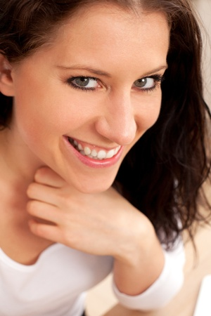 sweetly: Closeup portrait of a pretty woman smiling sweetly