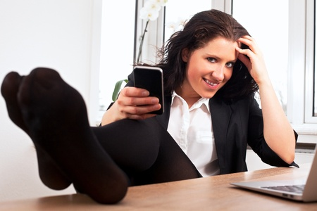 Portrait of a young businesswoman relaxing at the office Stock Photo - 13296245