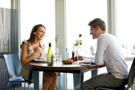dating couples: Portrait of a couple enjoying each others company in a romantic dinner Stock Photo