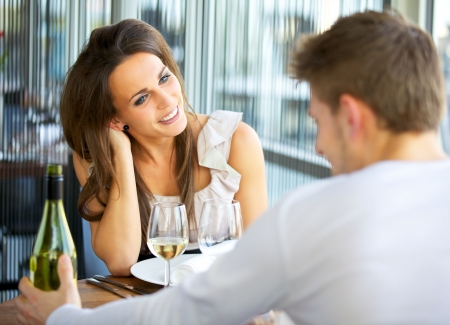 adult dating: Portrait of a romantic dating couple at a restaurant