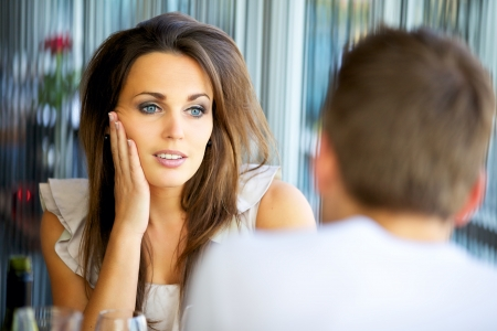 Portrait of an attractive lady staring at her boyfriend with love Stock Photo