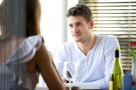 Portrait of a man in a serious conversation with his girlfriend in a restaurant photo