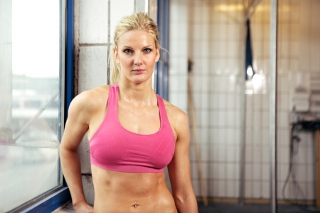 sweaty: Portrait of a young fit woman in sportswear during a fitness workout. Stock Photo