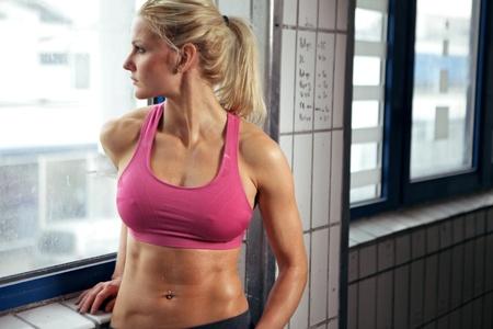 having a break: Young woman having a break in her fitness workout.