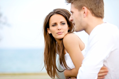 couple talking: Portrait of an attractive woman seriously listening to her boyfriend while on a date