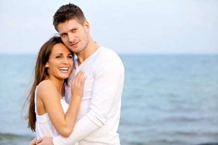 Portrait of an attractive couple enjoying the beach photo