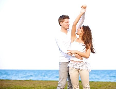 Portrait of a sweet couple having fun and dancing together outdoors  photo