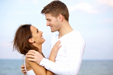 couple cuddling: Portrait of a lovely couple looking at each other with affection Stock Photo