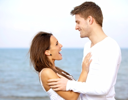 Portrait of a couple enjoying each others company at the beach photo