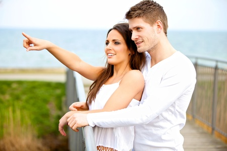 Portrait of a happy young couple dating outdoors photo