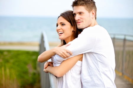 Portrait of a happy couple embracing while in the park photo