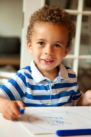 Portrait of a preschooler looking happy after finishing his homework Stock Photo - 14754537