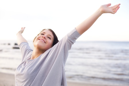 outstretched arms: Woman stretching her arms to enjoy the fresh air of the sea