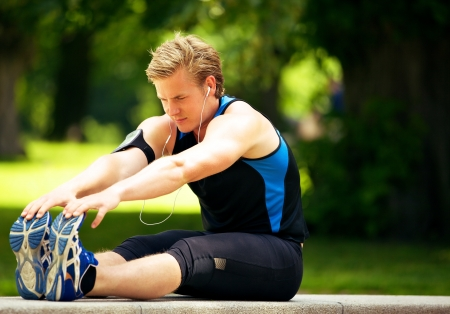 hamstrings: Attractive athlete doing his stretching exercise