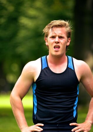 Exhausted young athlete looking frustrated after training photo