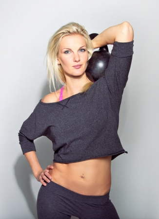 Woman with heavy kettlebell ready to do a workout photo