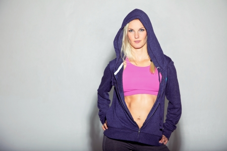 girl in sportswear: Portrait of beautiful fitness girl in blue sweatshirt  Copy space left   Stock Photo