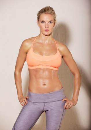 sweaty: Attractive woman at the gym with fit body posing against white background Stock Photo