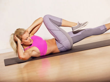 situp: Athlete doing situp exercise to keep her body in shape