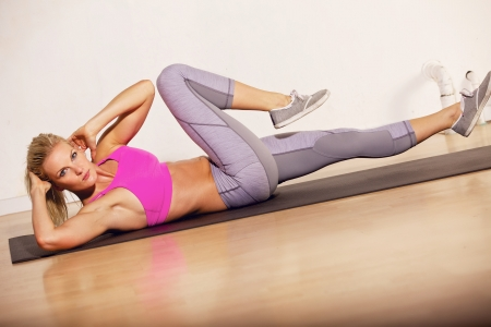 situp: Gorgeous woman in the gym doing her situp exercise Stock Photo
