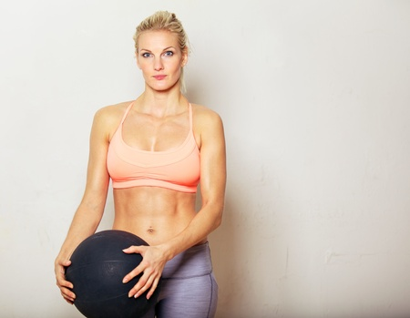 toned: Portrait of a fitness woman holding an exercise ball Stock Photo