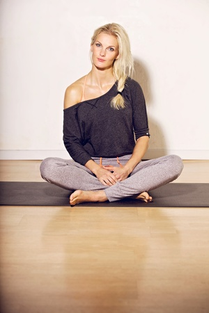 Confident fitness woman sitting on the floor photo