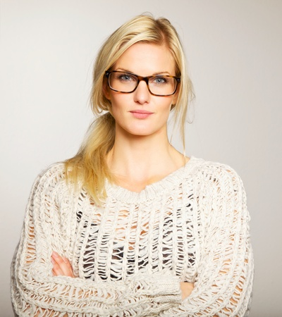 eyeglass: Lovely and smart woman with blank expression wearing her eyeglasses